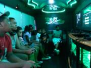 rolling video games limo bus party