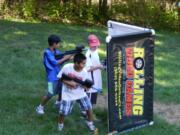 children at rolling video games laser tag party